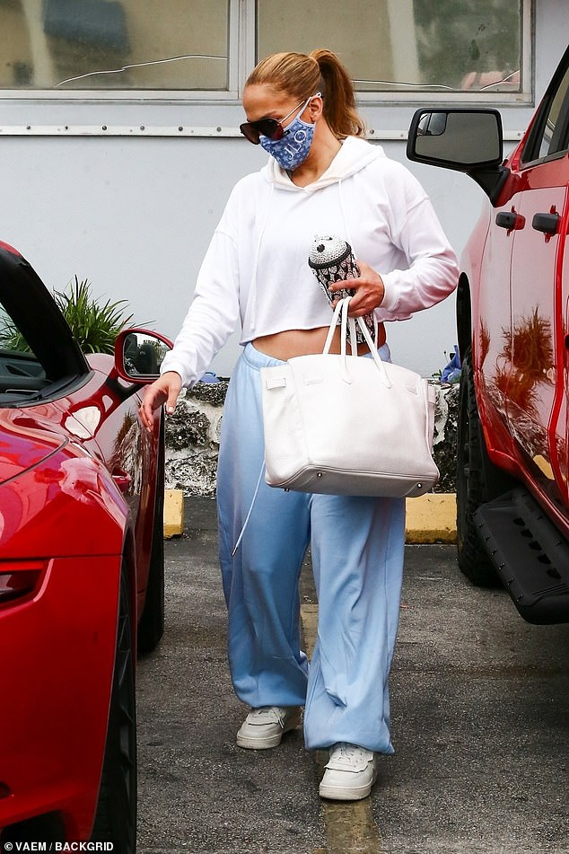 Relaxed: The singer and actress, 51, kept it casual in a cropped hoodie and baggy joggers