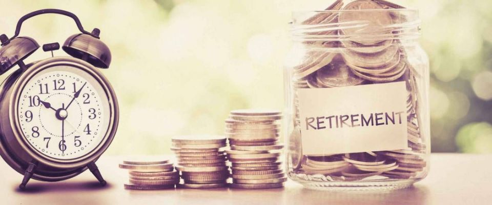 Put hand coins in glass jar with old alarm clock to save time to save money for retirement concept, vintage color tone