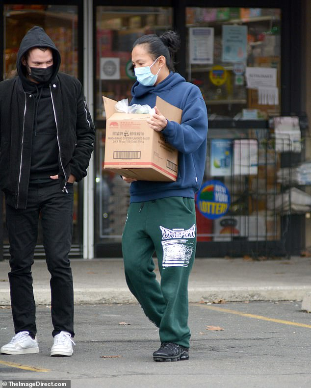 Spotted: Alexander Wang (right) joined a man's companion at an Asian supermarket in Skarsdale, New York on Monday in his first sighting since he denied numerous allegations of assault and sexual harassment.